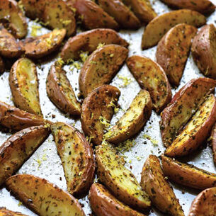 Crispy Roasted Potato Wedges with Parsley, Rosemary, and Lemon