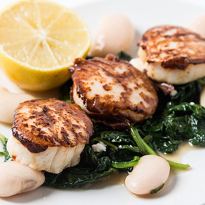 Grilled Scallops with Wilted Spinach and Lemon-Caper Butter