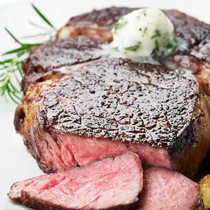 New York Steaks with Chive Butter and Merlot Sauce