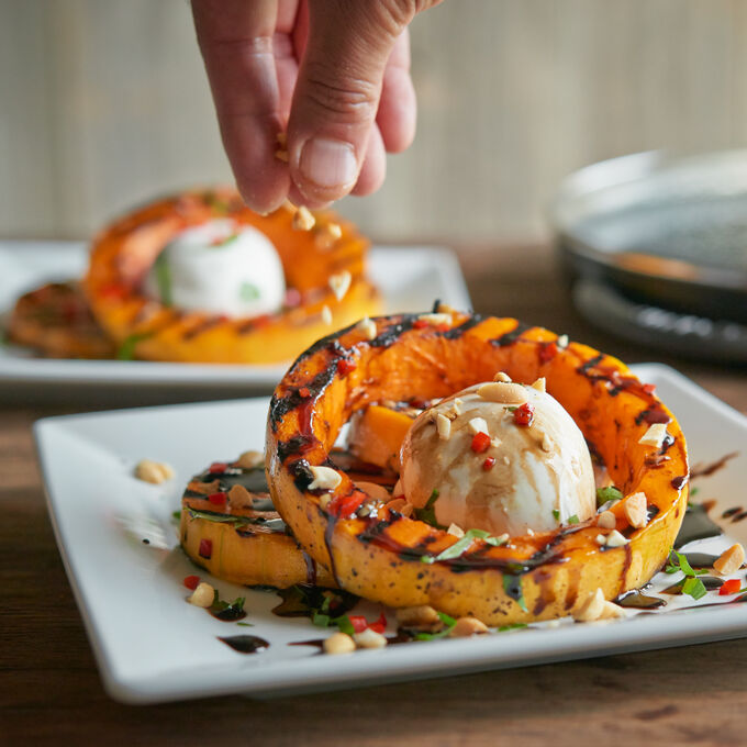 Steam-Grilled Butternut Squash, Burrata, Roasted Hazelnuts and Balsamic Reduction