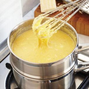Pan Seared Scallops, Warm Tomato, Caper and Olive Relish with Creamy Polenta