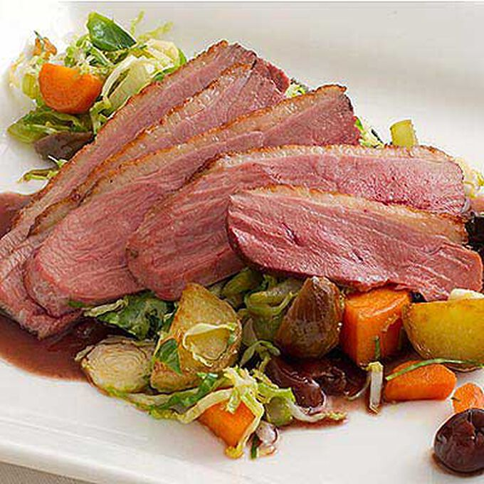Pan Seared Duck Breast with Two Potato Hash and Dried Cherry Sauce