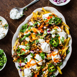 Instant Pot Carnitas-Loaded French Fries with Poached Eggs