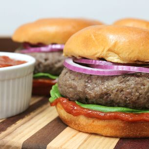 Angus Beef Burgers with Chipotle Ketchup, Spicy Onions and Marinated Tomato Salad