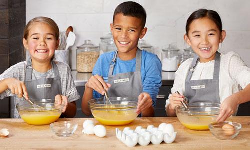 kids whisking eggs