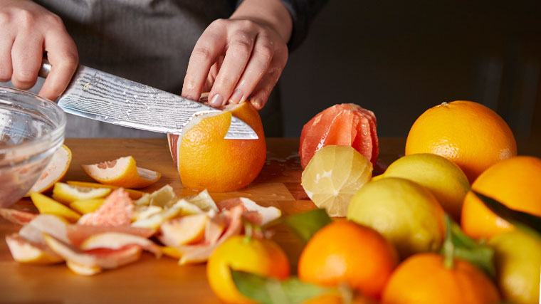 chef slicing citrus fruits