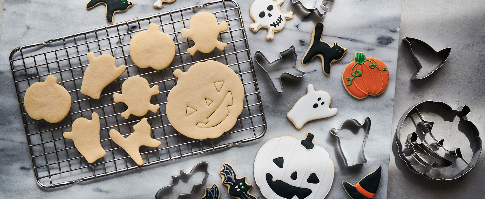 Decorated Halloween cookies and cookie cutters.