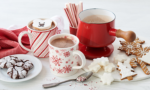 hot chocolate in mugs and chocolate pot