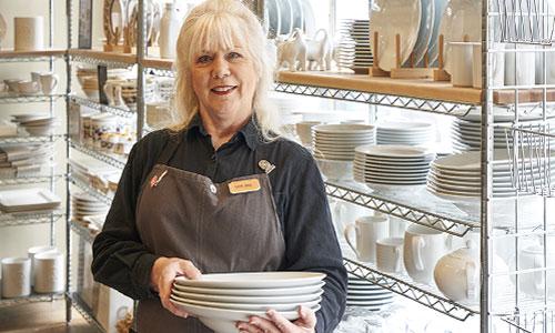 Sur La Table employee Darlene in gray apron