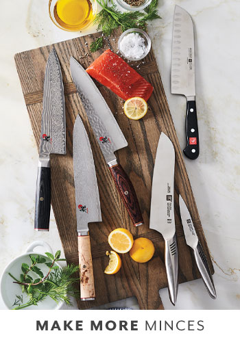 chef's knives and paring knife on wooden cutting board
