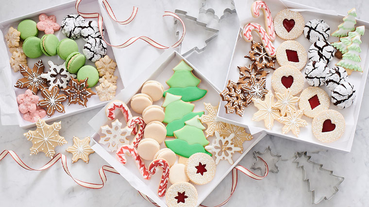 Decorated Christmas cookies in white gift boxes