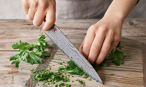 chefs knive chopping parsley