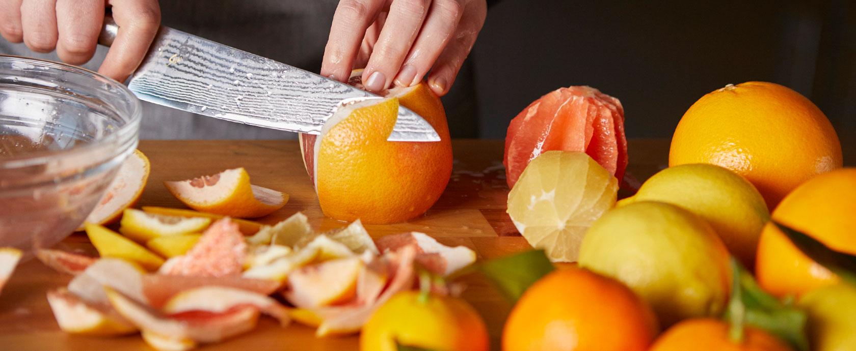 chef slicing citrus fruit