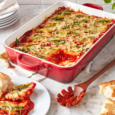 Stuffed shells in red baking dish, Cooking from the pantry Cooking Class with Sur La Table