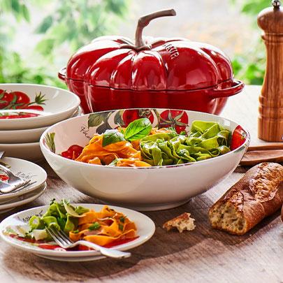 Staub tomato cocotte and tomato dinnerware