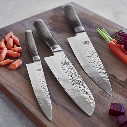 Shun Premier Grey knives on cutting board