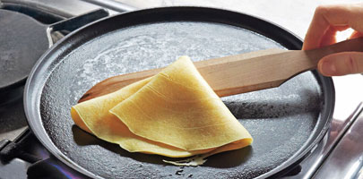 Staub crepe pan with wooden spatula