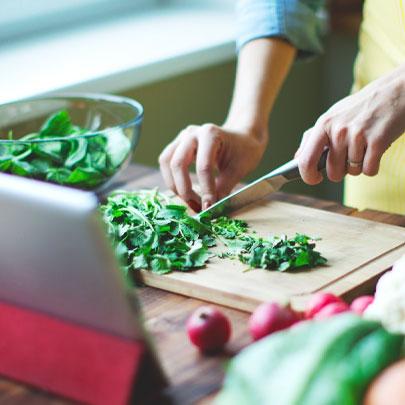 home chef chopping herbs
