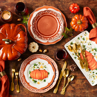 Pumpkin dinnerware and gold flatware
