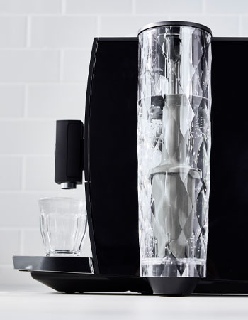 Jura coffee maker side view of water carafe