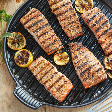 salmon and lemons in grill pan