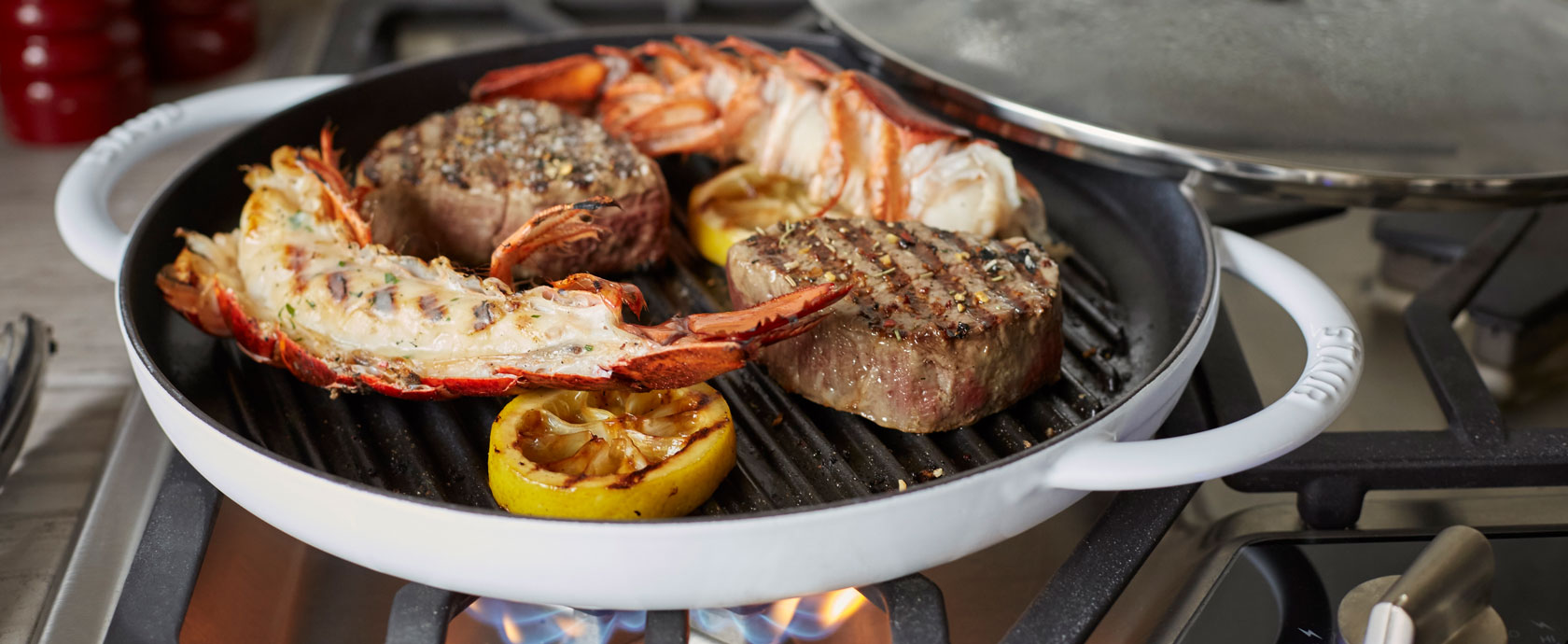 Staub steam grill pan with steak and lobster