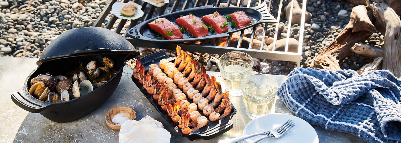 Cast iron grilling cookware on wooden table