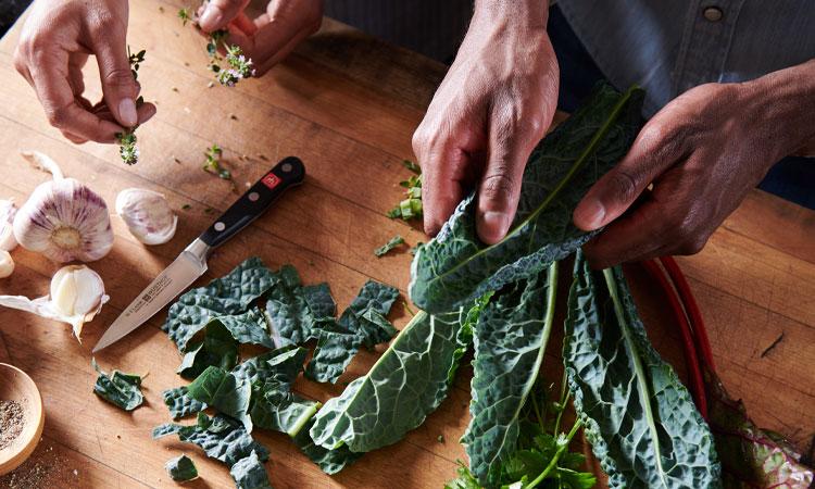 people chopping kale