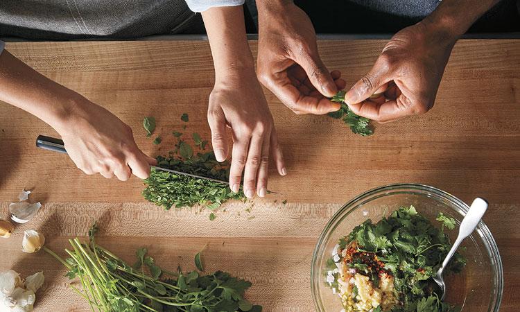 chopping herbs on cutting board