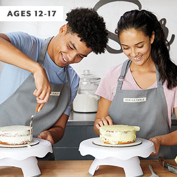 ttwo teens frosting cakes