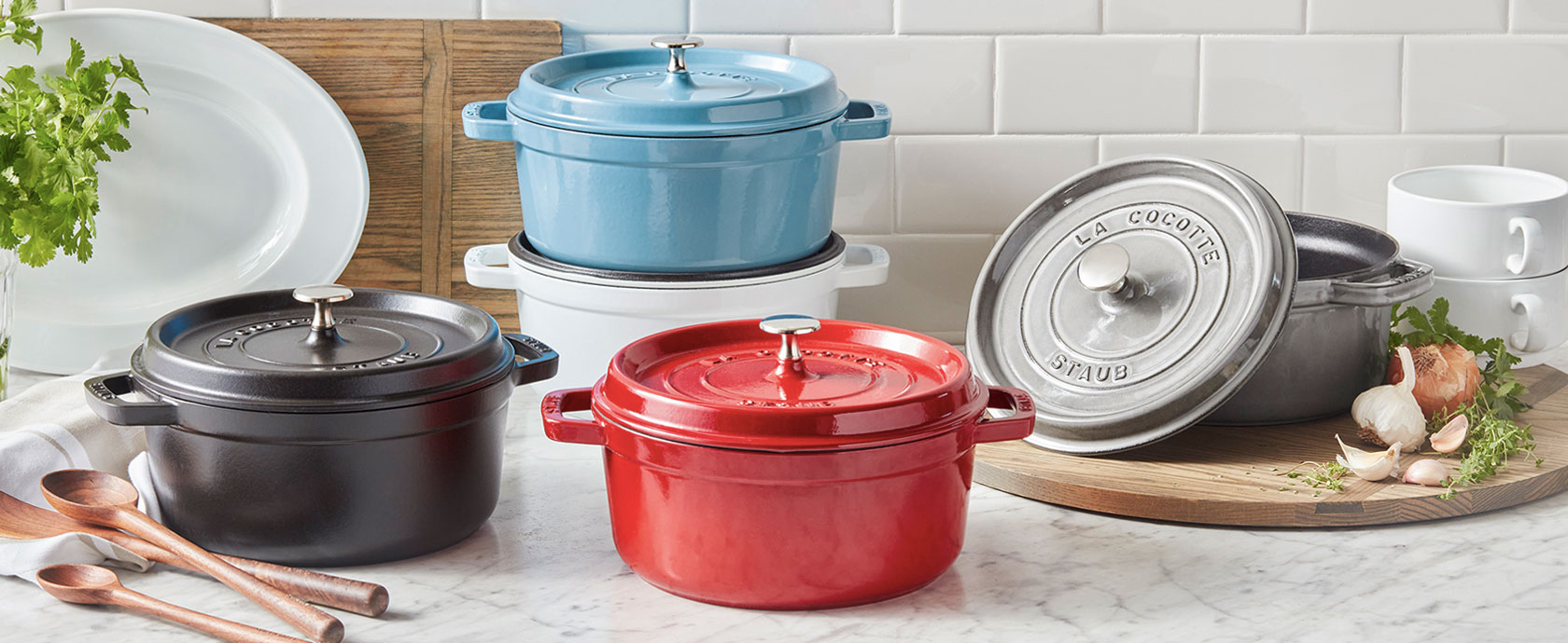 Staub cocottes in various colors
