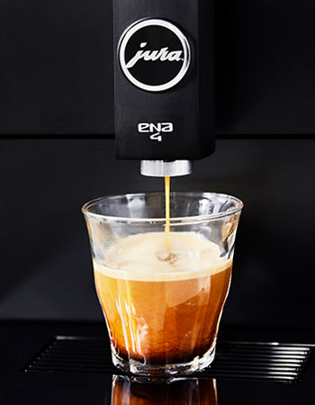 coffee brewing into glass