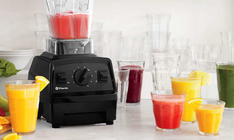 Vitamix with various smoothies and juices
