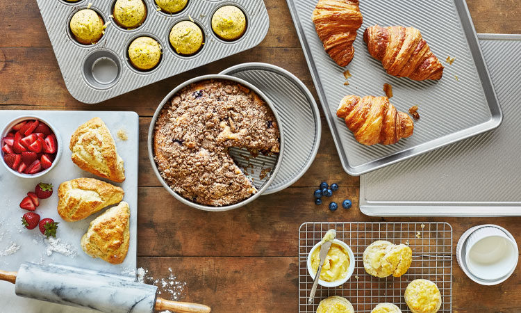 Sur La Table bakeware with muffins, cake and croissants