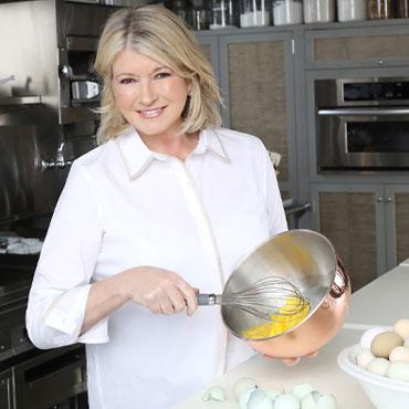 Martha Stewart whisking eggs in kitchen