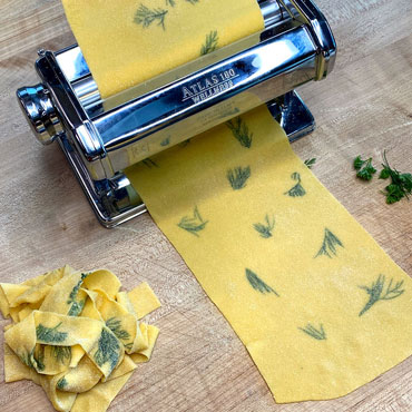 Fresh pasta sheet with herbs