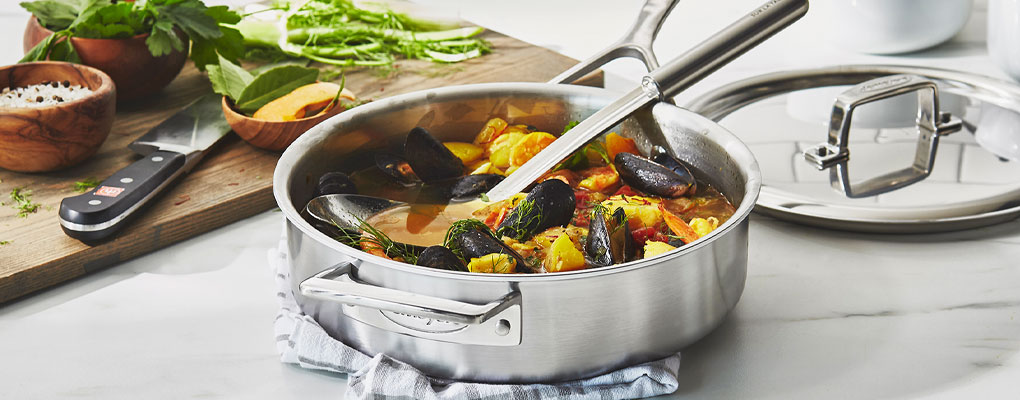 Demeyere stainless steel deep saute pan with mussels