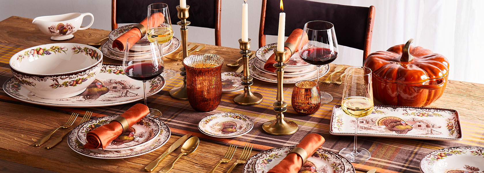 Thanksgiving table with turkey dinnerware