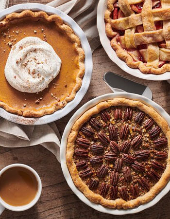 White pie dishes with homemade pie