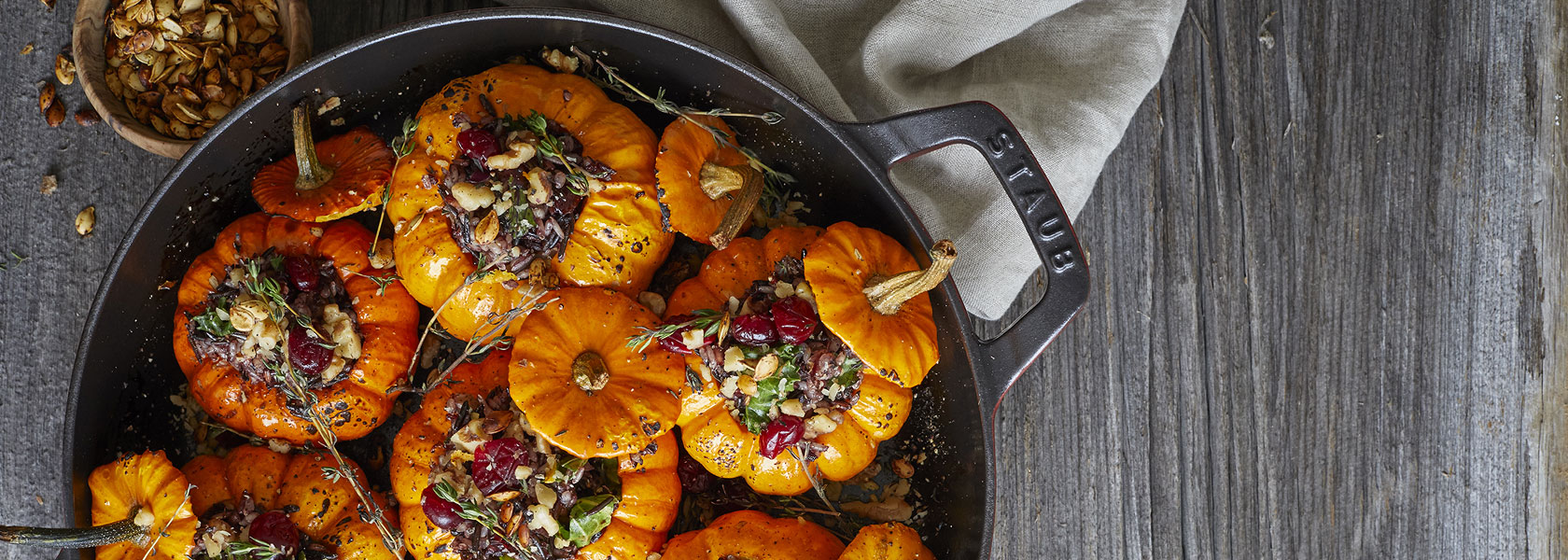 Staub All-Day Pan with stuffed mini pumpkins