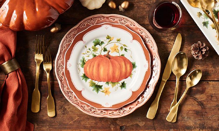 Pumpkin plate with gold flatware