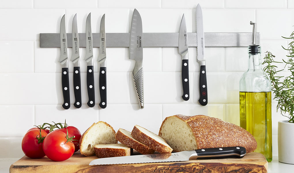 Chef knives on wooden cutting board
