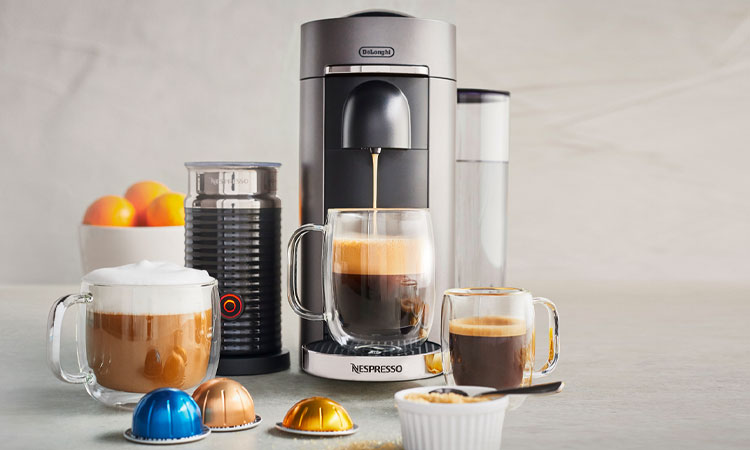 Nespresso coffee and espresso machine with milk frother.