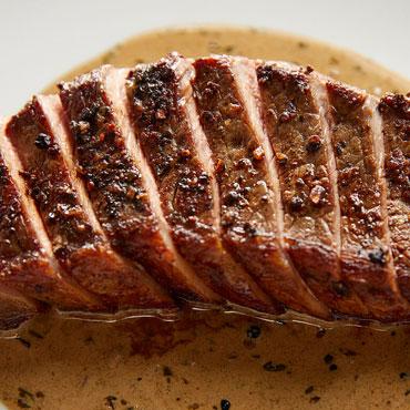 Steak au Poivre sliced