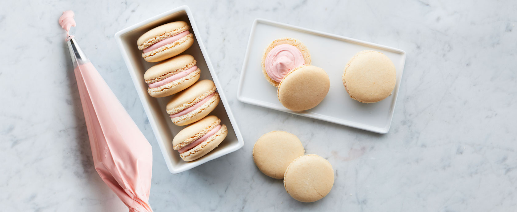 vanilla macaron cookies with pink filling