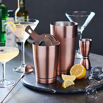 copper cocktail shakers and martini glasses