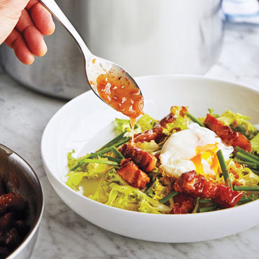 bowl of greens and soft poached egg