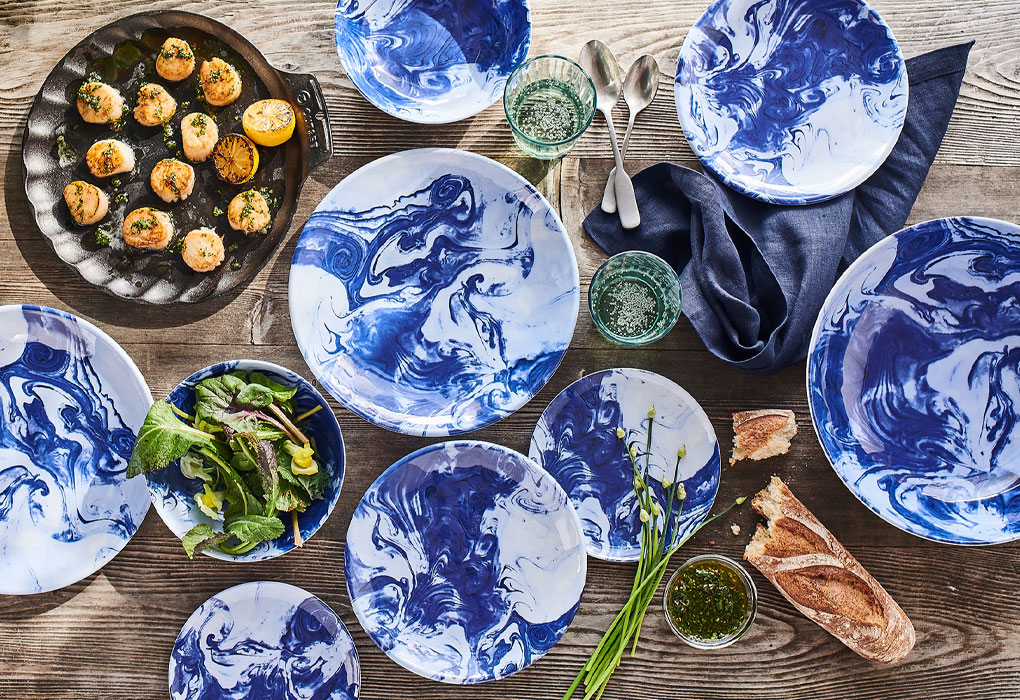 Oceana blue and white outdoor dinnerware and scallop cast iron grill pan