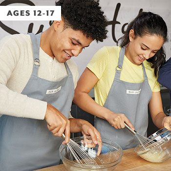 two teens whisking eggs