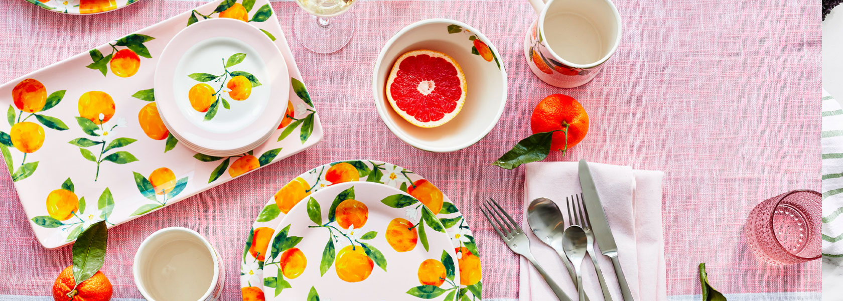 Lemon Dinnerware on pink tablecloth
